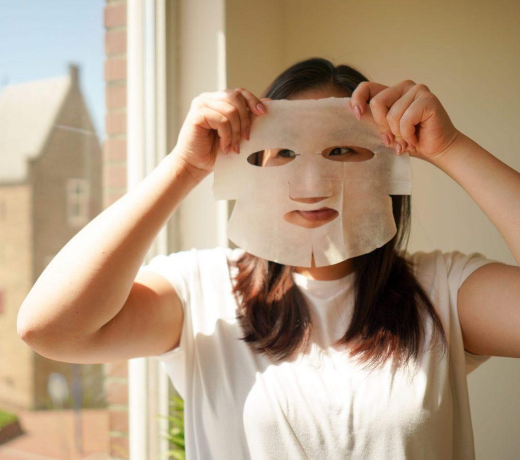 Girl holding up EGGXPERT's sheetmask